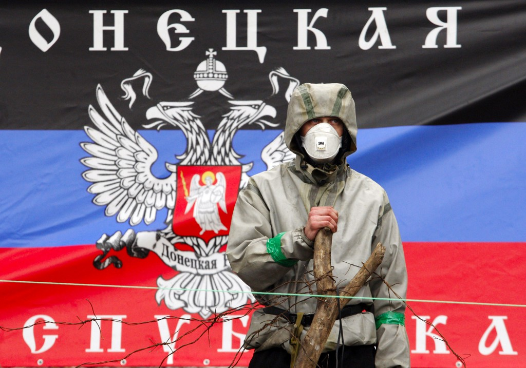 A pro-Russian militiaman guards a barric