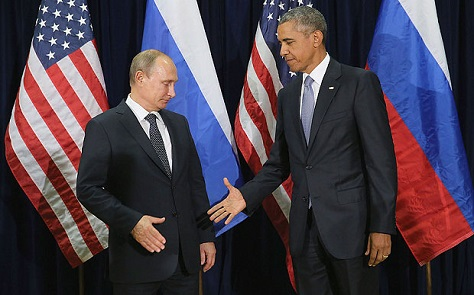 Putin and Obama shake hands for the cameras at the United Nations in New York yesterday. (Reuters)
