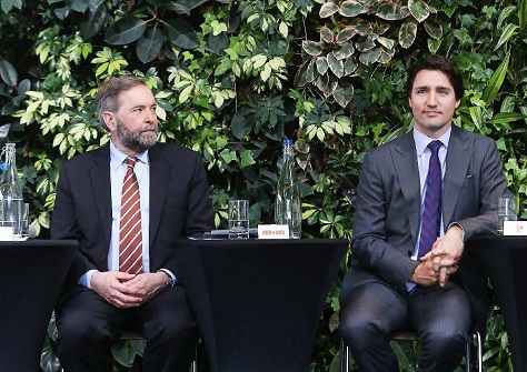 NDP leader Thomas Mulcair and Liberal leader Justin Trudeau partipicate in a March 2014 forum. (Jean Levac / Ottawa Citizen)