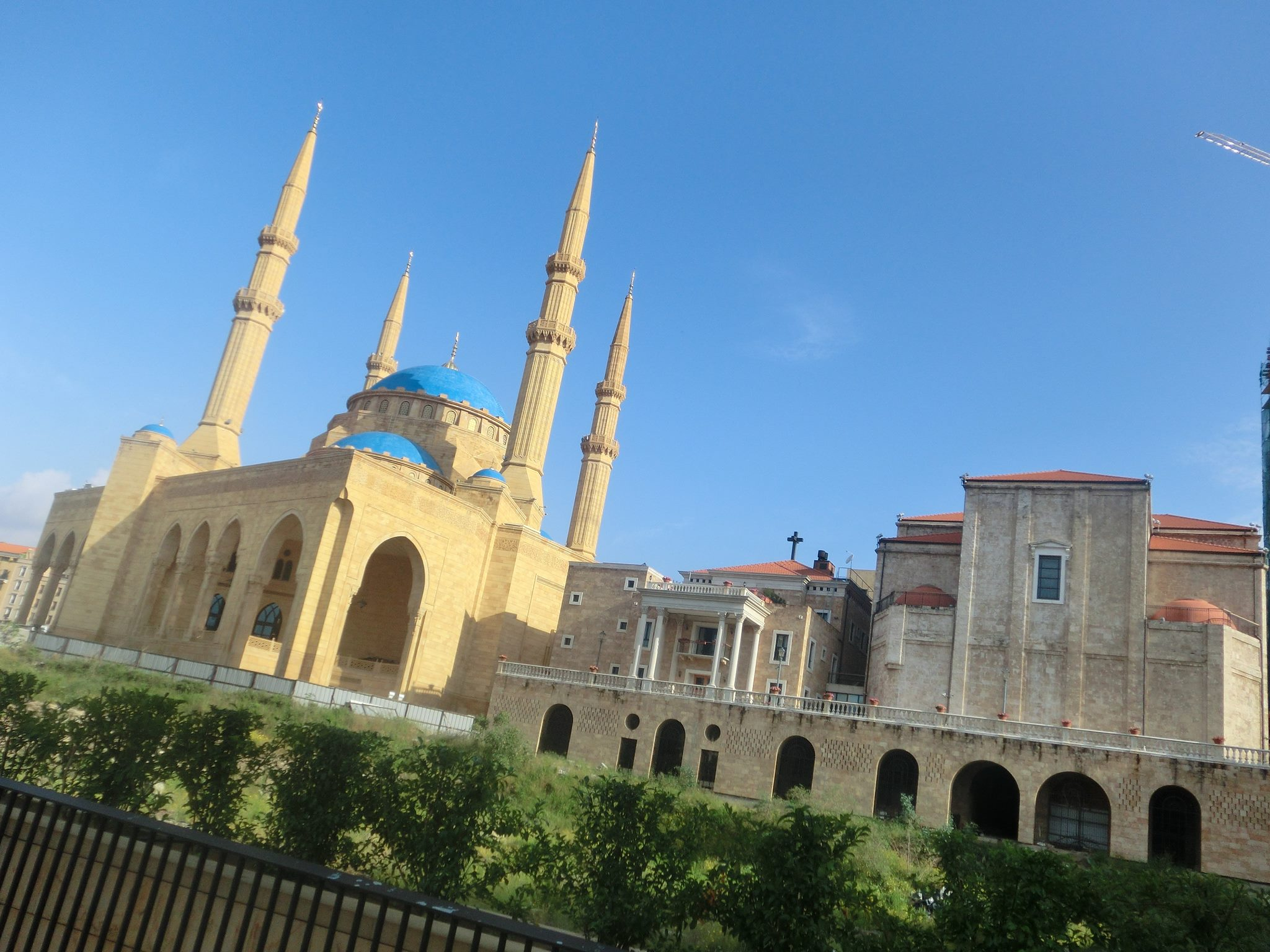 The Mohammad Al-Amin Mosque and the Saint George Maronite Cathedral stand side by side in Martyr's Square in downtown Beirut. (Kevin Lees)