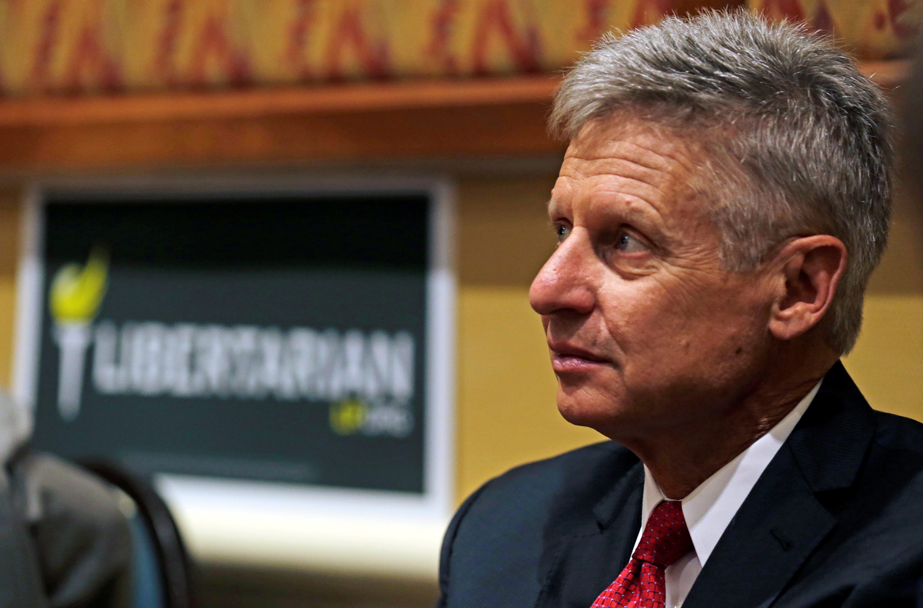 Libertarian Party presidential candidate Gary Johnson looks on during National Convention held at the Rosen Center in Orlando, Florida, May 29, 2016. REUTERS/Kevin Kolczynski - RTX2EQ7N