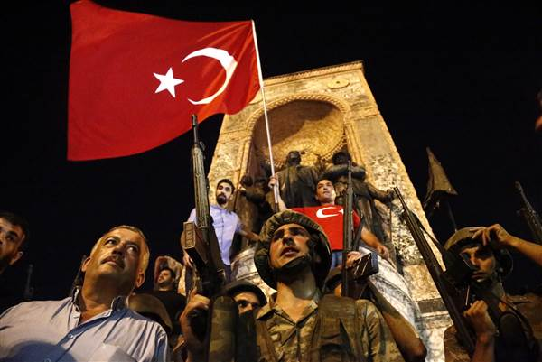 Turkish soldiers stand guard in Taksim Square Saturday night. (Sedat Suna / EPA)